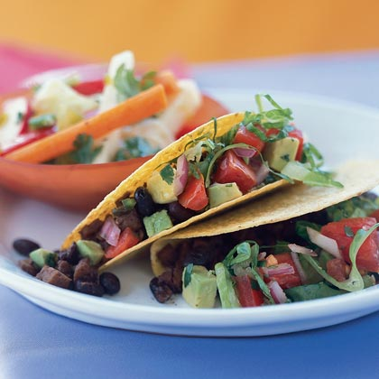Black Bean Tacos RecipeThis veggie taco is loaded with protein from the beans and seitan (wheat gluten). Look for seitan in health food stores or near tofu in larger supermarkets. If you prefer to skip the seitan, use another can of black beans, tofu, beef, or chicken in its place.