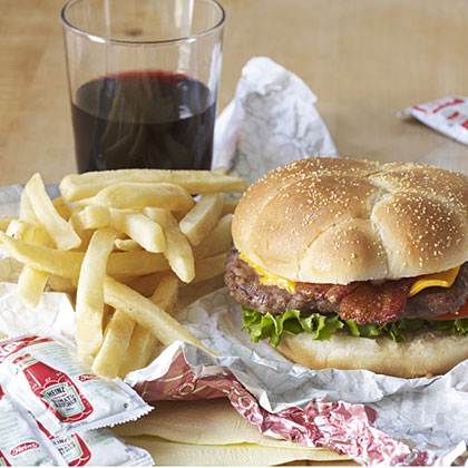 Pairing wine with a bacon cheeseburger and fries.