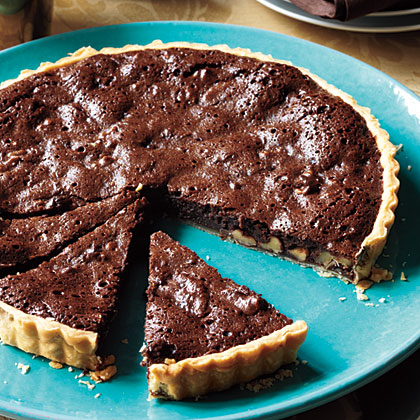 Chocolate Walnut Tart RecipeA riff on the classic pecan pie, this dessert is rich, chocolaty, and a little fancier with its freestanding fluted sides. Of course, you can use a 9-inch pie plate if you don't have a tart pan with a removable bottom.