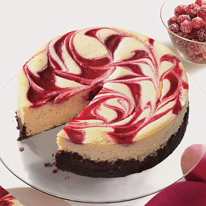 Cranberry Swirl Cheesecake RecipeImpress your guests with a stunning cranberry cheesecake.  The secret of the rich but reduced-fat filling is the combination of reduced-fat and fat-free cream cheese and Greek yogurt.