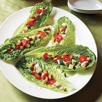 Caesar Salad Bites RecipeTurn this classic salad into an appetizer by spooning the vegetable mixture into romaine lettuce hearts and topping with croutons and a creamy Caesar dressing.