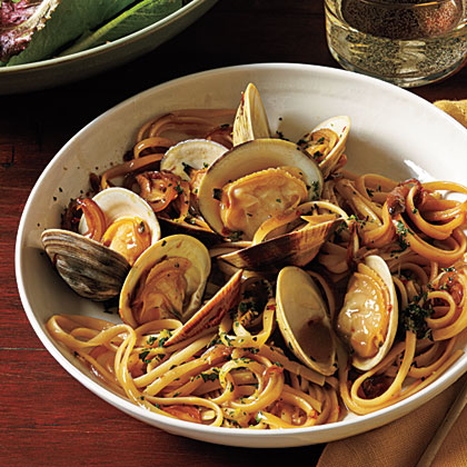 Serve an Italian-inspired dish featuring quick-cooking linguine and clams in a light, fresh white wine sauce.Linguine with Clams and Fresh Herbs