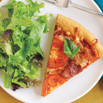 <p>Pizza with Prosciutto, Tomatoes, and Parmesan Cheese</p>