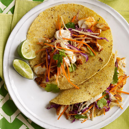 Fish tacos with cabbage carrot slaw spicy crema recipe for Fish tacos cabbage