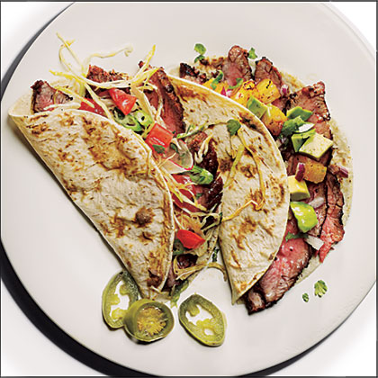 Flank Steak Tacos RecipeThese simple tacos, featuring gorgeous slices of grilled flank steak, have gotten outstanding reviews from fellow MyRecipes users.