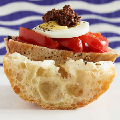 Mini Nicoise Sandwiches RecipeFor a creative twist on the classic Nicoise salad featuring tuna, hard cooked egg, olives, and tomatoes, serve these mini, open-faced sandwiches as appetizers at your next gathering.