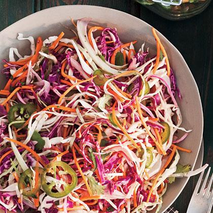 Jalapeño-Lime Slaw RecipeThis citrusy take on coleslaw is fresh and pleasantly spicy, making it an ideal side dish or burger or brat topping. Leave the seeds in more peppers for added fire, or seed all of them for a milder dish.