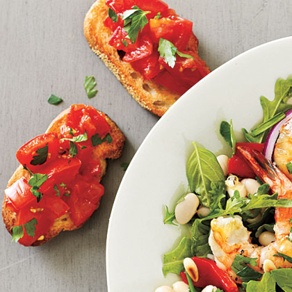 Tomato Toast RecipeSummer appetizers don't get any easier than this! Quickly sauté tomato with butter and parsley before topping fresh baguette.