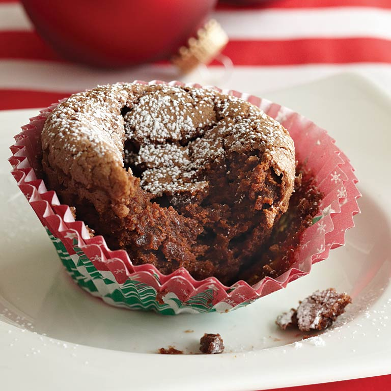 Fudgy Baby Cakes                            RecipeDon't let the unpretentious appearance fool you. These 8 simple ingredients transform into a decadent dessert that is irresistible. The middle becomes the perfect little pocket to hold sweetened whipped cream or ice cream.