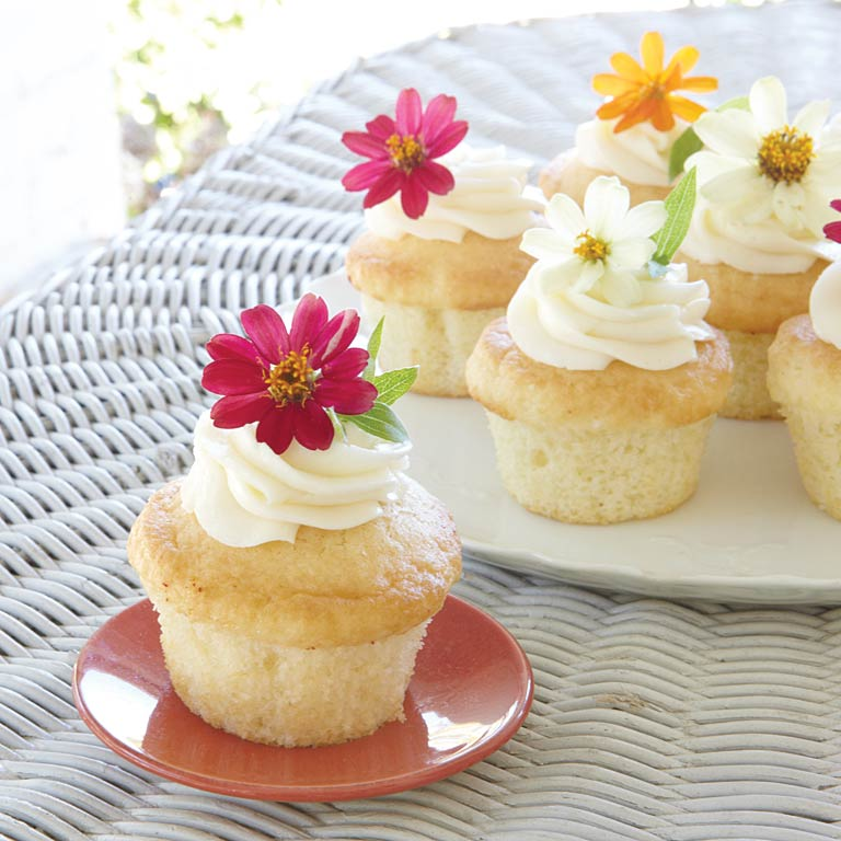 Garden Party Cupcakes RecipeThese light little bites are the most adorable sweet treats for an afternoon tea. Edible flowers were especially popular during Queen Victoria's reign; we think she would be pleased with this addition to tea time. Be sure your blossoms are nonpoisonous and free of pesticides. We've listed a few below that we think are lovely for any garden party.