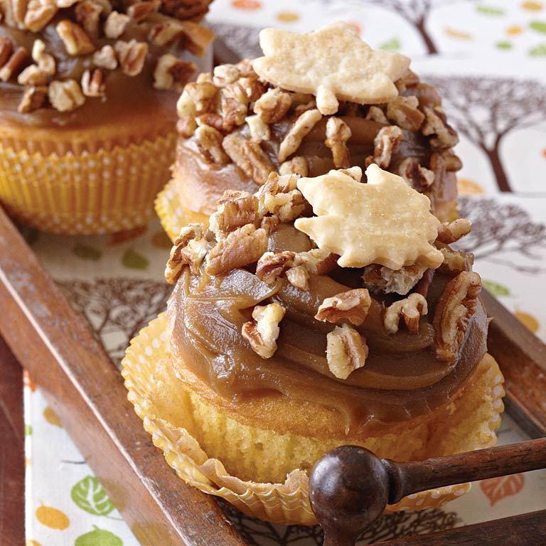 Pecan Pie is the quintessential dessert of fall. Crunchy toasted pecans and buttery Piecrust Leaves enhance the rich creamy frosting for a cupcake you'll make again and again.Pecan Pie Cupcakes Recipe