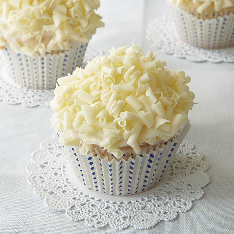 White Linen Cupcakes RecipeWhite Linen Cupcakes are a light combination of Mascarpone Frosting and white chocolate curls over a tender cupcake. Perfect for a tea, party, or shower, they're delicate and delicious. Serve them with an ice-cold glass of milk.