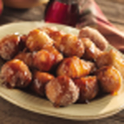 Apple Fritters with Spiced Syrup RecipeGolden brown fritters gently sprinkled with a sweet cinnamon mixture and covered in a slight drizzling of spiced syrup.