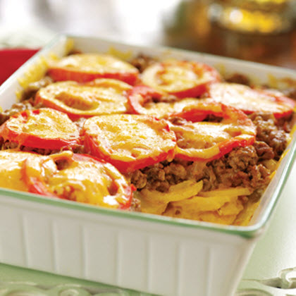 Bacon Cheeseburger Bake RecipeThis classic casserole dish is easily made with ground beef, potatoes, cheddar cheese, and tomatoes.