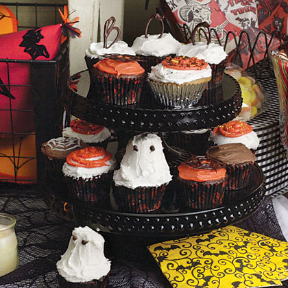 """Spooky Spiderweb Cupcakes RecipeDon't worry about making the """"webs"""" perfect...the more imperfect, the spookier the effect."""