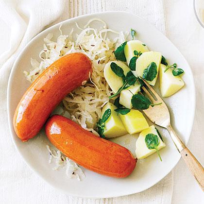 Wine-Glazed Sausages with Watercress Potatoes and Sauerkraut