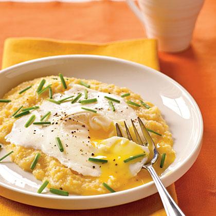 Eggs Blindfolded over Garlic-Cheddar Grits
