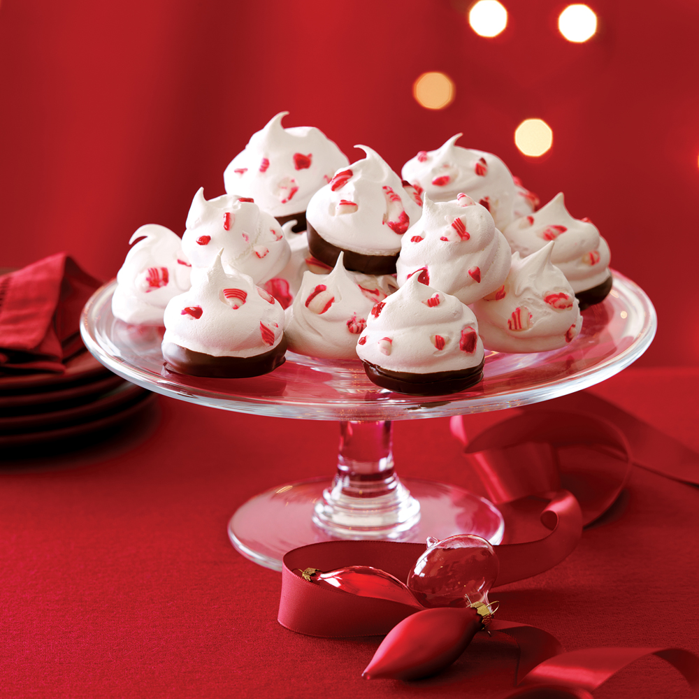 White Christmas Dream Drops RecipeUnlike traditional meringues, which are crisp all the way through, these are still chewy on the inside, like mini pavlovas—but with white chocolate chips and plenty of peppermint.