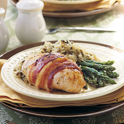 Bacon-Wrapped Chicken RecipeEach chicken breast is coated with herb-flavored cream cheese, rolled up and wrapped in bacon, making this dish an excellent choice for special get-togethers.