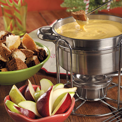 Cheddar Fondue RecipeDip bread cubes of all varieties along with apple and pear slices into this dreamy fondue. This elegant crowd-pleaser will definitely be a hit among holiday guests.