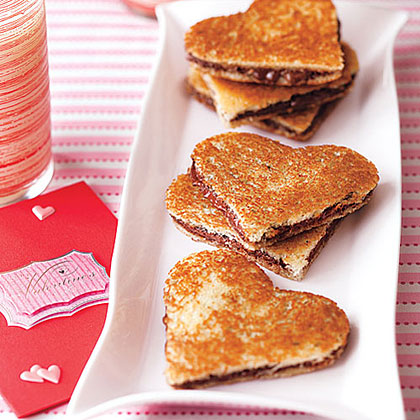 Chocolate Panini RecipeWarm your heart with warm melted chocolate sandwiched between buttery bread. Sprinkle with powdered sugar for a sweeter flavor.