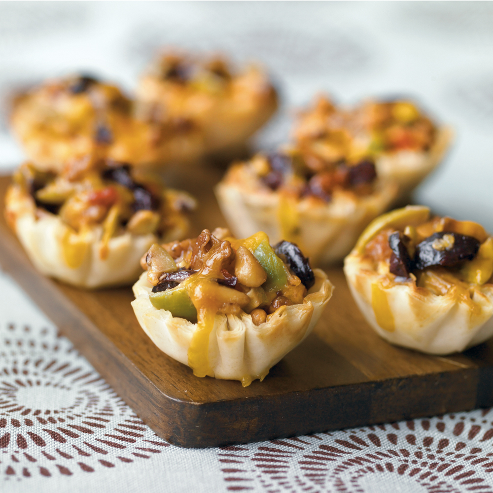 Greek Olive Cups RecipeFill mini phyllo cups with a mixture of olives, pecans, pine nuts, and cheese for a savory holiday appetizer offering.  These cups can be made ahead and frozen, so they're ideal for holiday entertaining.