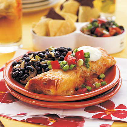 Chicken Burritos RecipeThese burritos are the perfect solution for what to serve on those busy nights when you need supper in a hurry! Just add Mexican rice or black beans to go along.