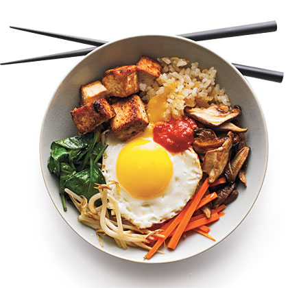 Bibimbop RecipeThis classic, all-in-one Korean dish features a little bit of everything: crisp veggies, marinated beef, rice, seasoned spinach, and a fried egg on top.
