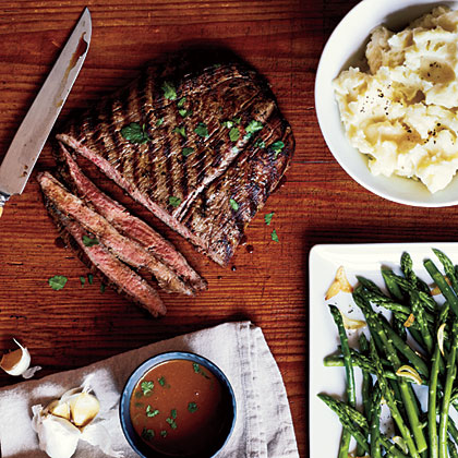 Serve pan-grilled flank steak with a soy-mustard sauce for a flavorful and budget-friendly steak supper.Pan-Grilled Flank Steak