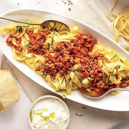 This pasta bolognese recipe, made with ground pork, red wine, and grated carrot will be a quick dinnertime favorite.Pasta Pork Bolognese
