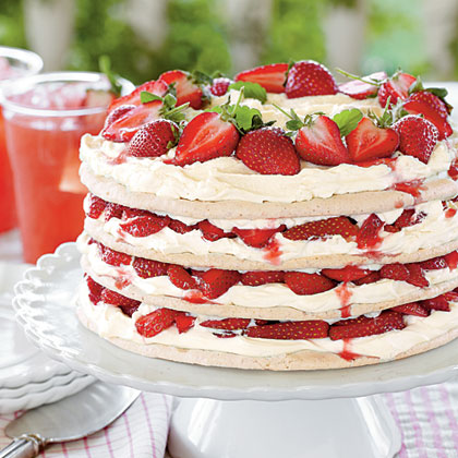 Strawberry Meringue Cake RecipeThis strawberry meringue cake features layers of sweet cream and fresh strawberries sandwiched between thin rounds of homemade meringue.  Serve this dessert in the springtime when strawberries are at their peak.
