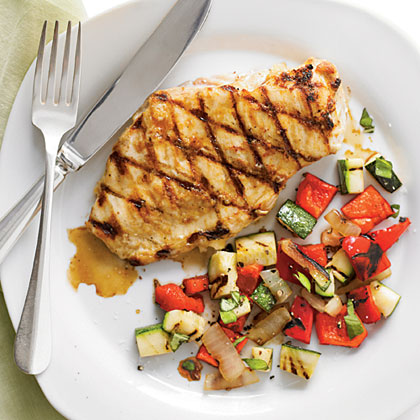 Top tender grilled chicken with a fresh salsa of zucchini, bell pepper, onion and basil for a colorful one-dish meal.Grilled Chicken and Garden Salsa Recipe