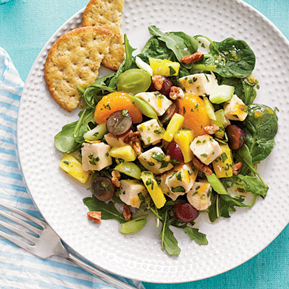 Start with chopped cooked chicken and add a colorful medley of fruit such as pineapple, grapes, and mandarin oranges for a colorful main dish salad.  Toss with orange vinaigrette and add chopped pecans for extra crunch.Mixed Fruit Chicken Salad Recipe