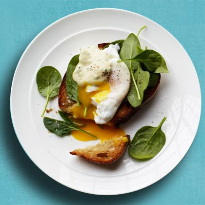 <p>Crostini with Spinach, Poached Egg, and Creamy Mustard Sauce</p>