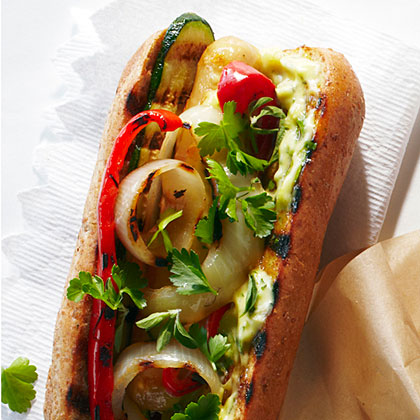 The Backyard Farmer Hot Dog RecipeHomegrown grilled vegetables top these hot dogs, along with a creamy aioli made with a backyard chicken egg and garden herbs.