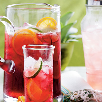 Iced Hibiscus Sweet Tea RecipeOffer beautiful, ruby red Iced Hibiscus Sweet Tea as a refreshing alternative to regular iced tea.