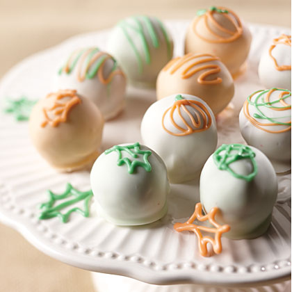 Try your hand at homemade cake balls with these bite-sized treats.  They feature iconic autumn designs like leaves, acorns, and pumpkins.Autumn Cake Balls Recipe