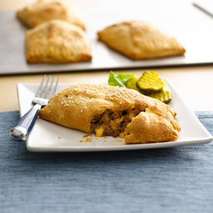Enjoy these cheeseburger hand pies made with beef and Pillsbury® Big & Flaky crescent dinner rolls - a tasty dinner that's ready in 30 minutes.
