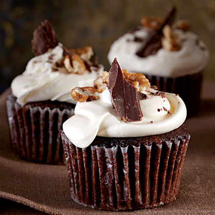 Mississippi Mud Cupcakes RecipeHere's a cupcake version of the classic Southern chocolate sheet cake that's filled with marshmallows and chopped pecans and topped with a rich chocolate frosting.