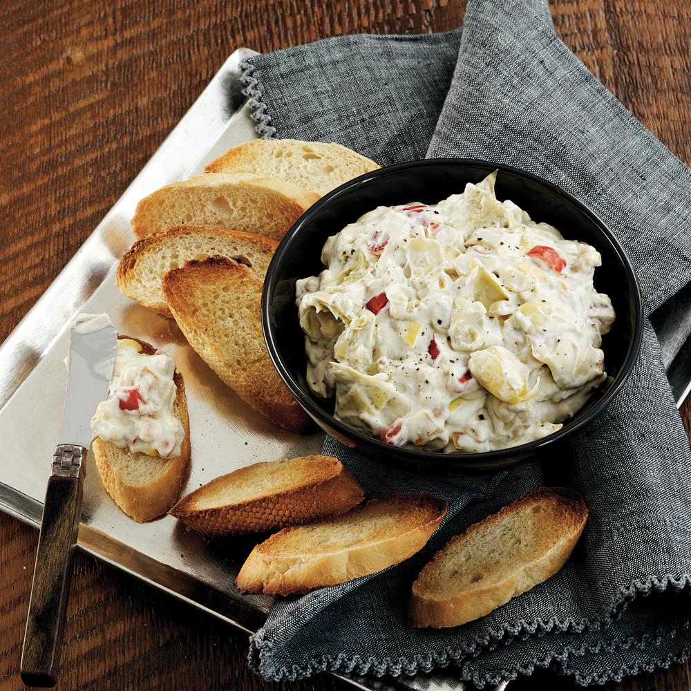 Blue Cheese-Artichoke Dip RecipeBlue cheese amps up the flavor for a little twist on the traditional artichoke appetizer. The dip holds up well for about two hours after the cook time. Serve with pita chips or toasted baguette slices.