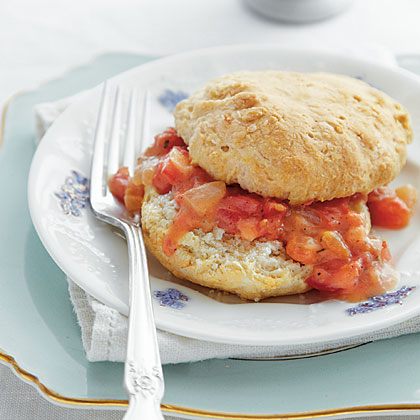 Cat-head Biscuits with Tomato Gravy RecipeCat-head biscuits are delightfully huge, crispy-on-the-outside, fluffy-on-the-inside homemade biscuits. Their size and crunch make them ideal to serve with a thick, hearty gravy. The name comes from their colossal size, about that of a cat's head. They bake longer and at a lower temperature than their smaller cousins. If you don't have bacon drippings on hand, cook a pound of bacon before you start this recipe, reserve the drippings, and serve the bacon with the biscuits and gravy.