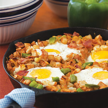 Breezy Brunch Skillet RecipeThis easy brunch dish, filled with bacon, diced potatoes, eggs, and cheese, is great for entertaining since the whole recipe is cooked in one skillet and cleanup is a breeze.