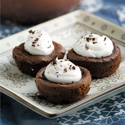 Mini Mousse Cupcakes RecipeChocolate, mousse, and flour--plus whipped cream for topping--are all that's needed to enjoy a quick sweet treat after dinner. There are only 3 words to describe these baby bites: simple heavenly decadence.