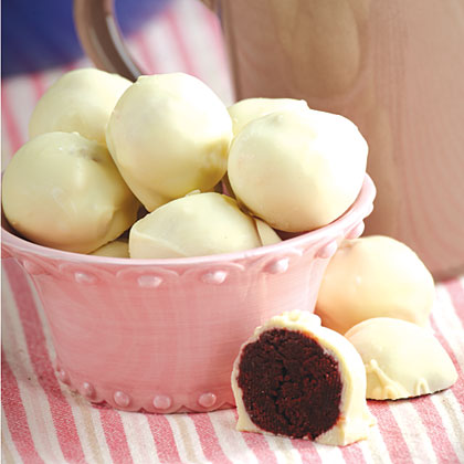 Red Velvet Cake Balls RecipeRed Velvet Cake balls are the perfect bite size dessert. They are incredibly easy to make and an easy-to-pick up tailgate treat.