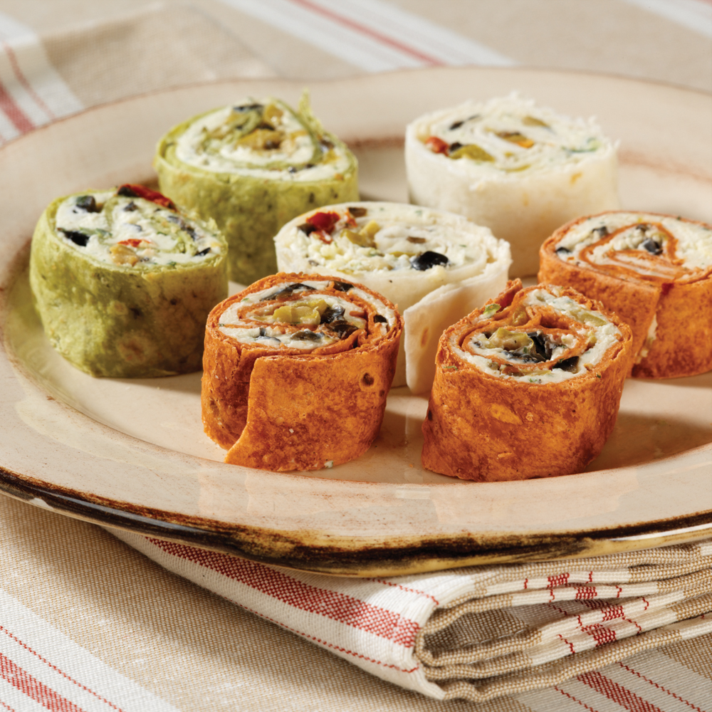 Touchdown Pinwheels RecipeThe best tailgate dishes are those that can be served at room temperature or even chilled. These too-cute pinwheels fit that category perfectly!