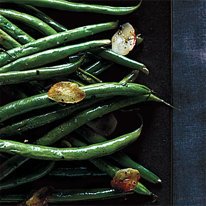 "Garlic Haricots Verts RecipeFrench for ""green beans,"" Haricots Verts refers to a longer, thinner type of green bean than the typical American green bean. Garlic, olive oil, salt and pepper is all you need to bring out the best flavor in this dish."