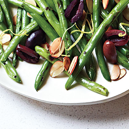Olive-Almond Green Beans RecipeMove over plain green beans for a side serving of Olive-Almond Green Beans. The kalamata olives give these beans its saltiness, toasted almonds a bit of crunch, and a touch of citrus thanks to lemon rind.