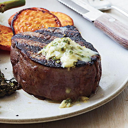 Top tender filet mignon with a chive-horseradish butter for an indulgent, 4-ingredient recipe that comes in at only 220 calories per serving.Steak with Chive-Horseradish Butter