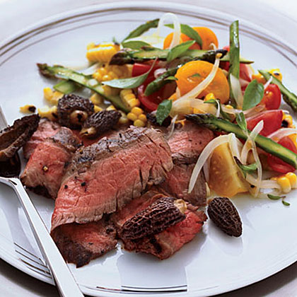 Grilled Flank Steak with Corn, Tomato and Asparagus Salad RecipeThe accompanying salad would also be delcious on its own as a first course, but makes a perfect partner for tasty grilled flank steak.