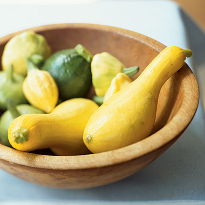 In warm, moist, and sunny conditions, summer squash varieties (such as yellow squash and zucchini) are a gardener's best friend. Squash can easily be grown in containers and each plant produces very high yields. Harvest summer squash when it's six inches long. As it grows larger, it will lose flavor.Think of squash in pastas, on pizzas, and in delicious quiche.